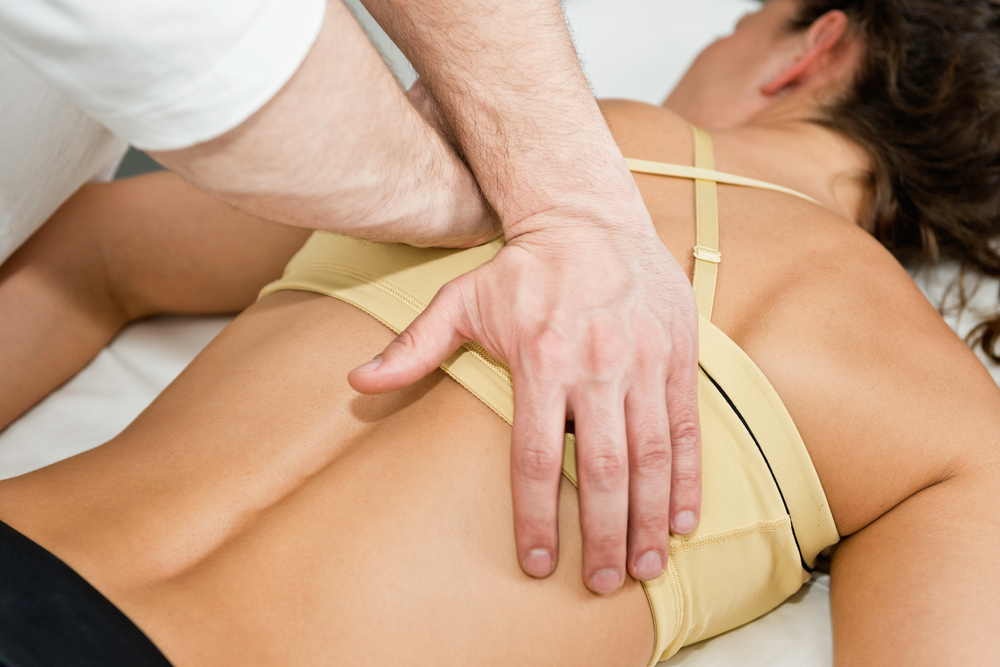 patient receiving a massage from her chiropractor