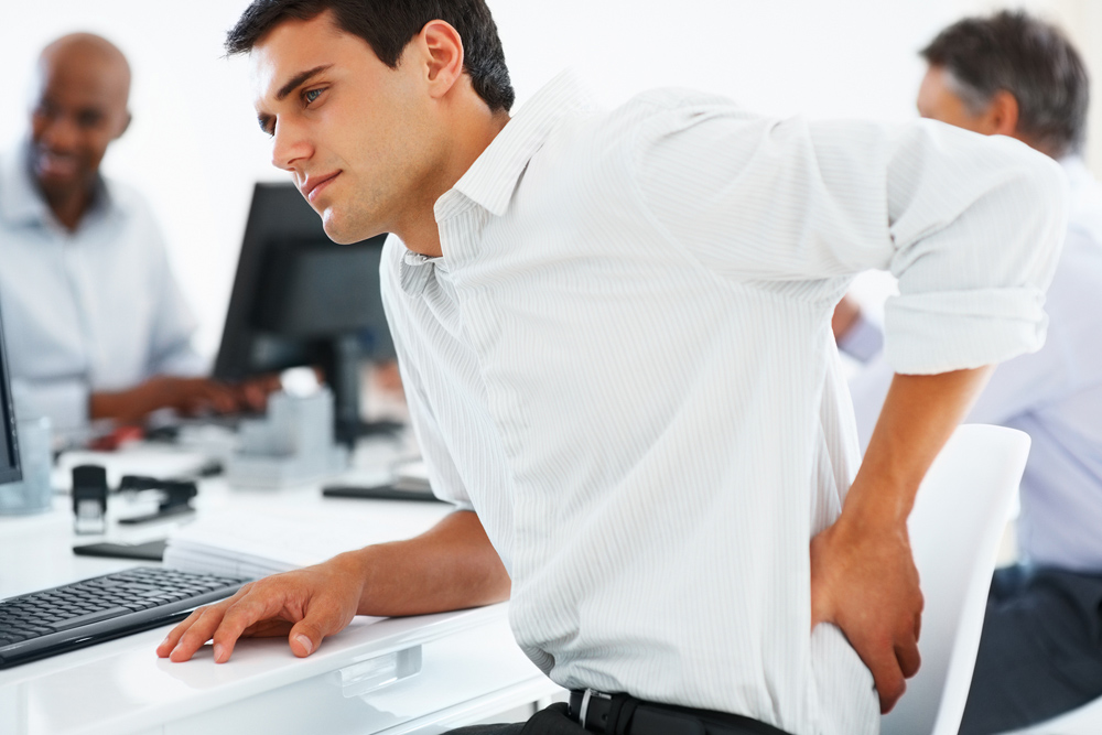 Man with Lower Back Pain in the office.