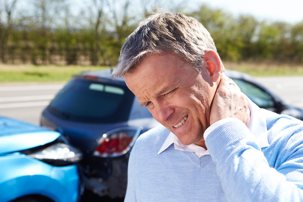 Man with whiplash needs to seek chiropractic care.